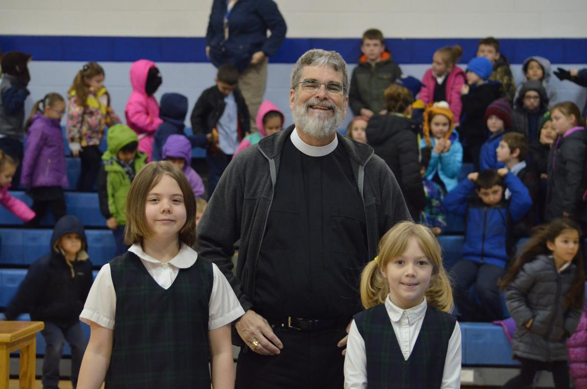 Br. Guy with two children