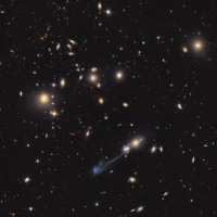 NGC 3561, by Adam Block/Mount Lemmon SkyCenter/University of Arizona, USA.  Billions and billions of galaxies, or at least hundreds can be seen in this galaxy cluster dominated by interacting pair NGC 3561 A and NGC 3561 B.