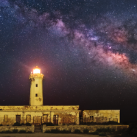 Milky Way Behind The Lighthouse of Plemmirio – Syracuse, Sicily, by Dario Giannobile, Italy.  The Milky Way rises like a giant cloud over the Plemmirio Lighthouse in Sicily.