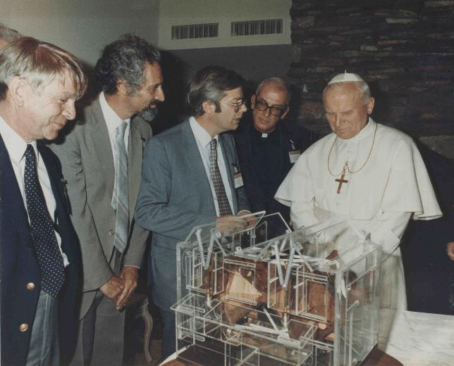 Pope John Paul II visiting Arizona, with members of the Arizona astronomy department describing their plans for an observatory including a telescope for the Vatican, 1987.