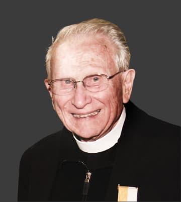 Rev. Andrew Whitman, S.J.