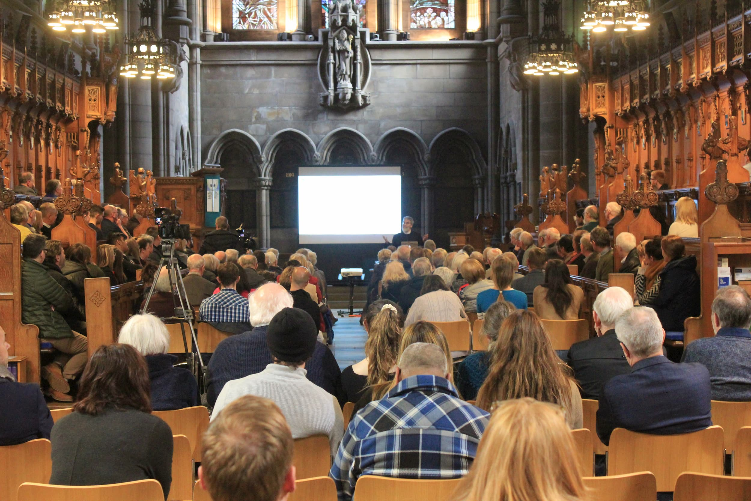 Br. Guy Consolmagno S.J. speaking at the University of Glasgow Memorial Chapel