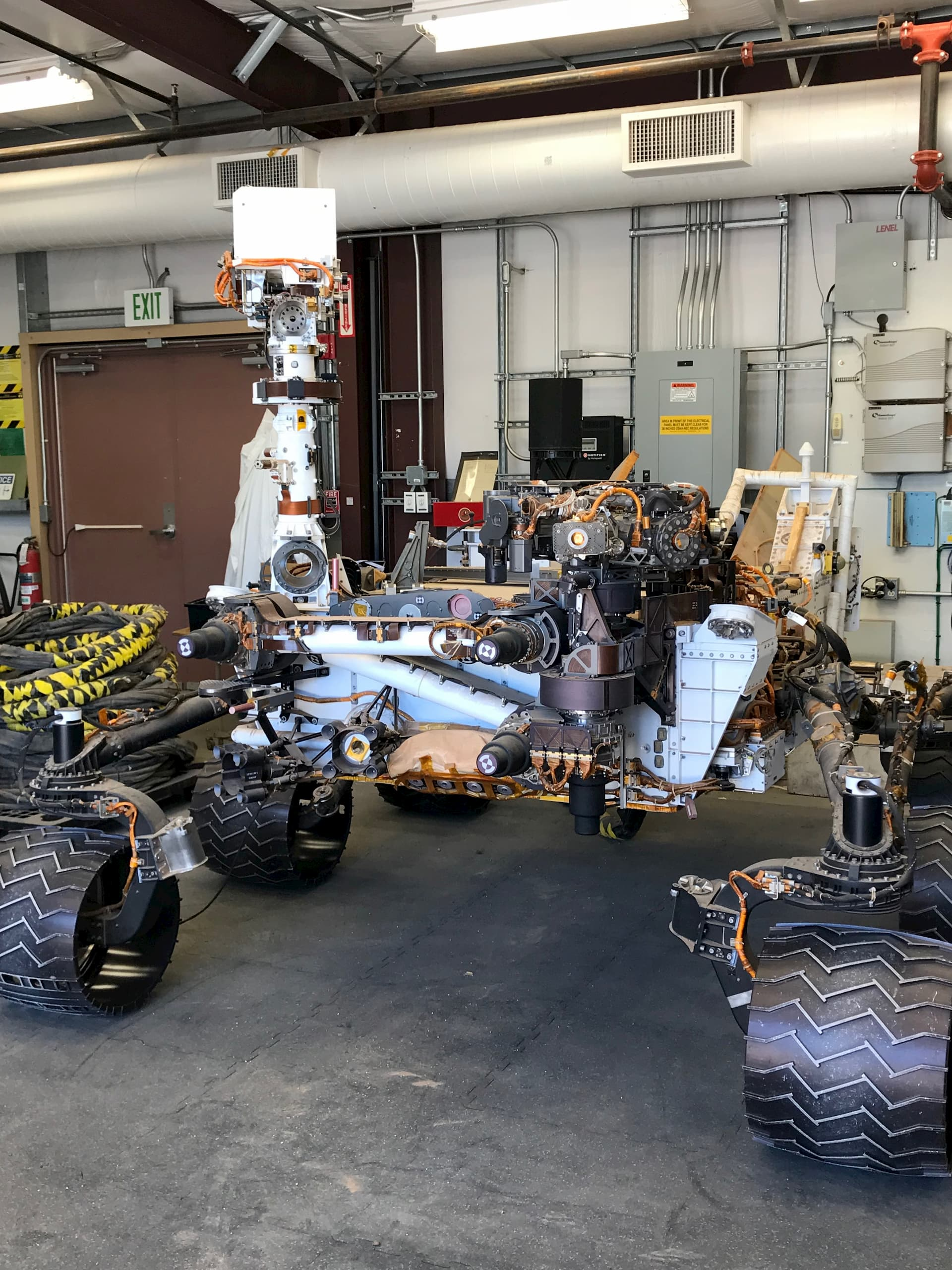 """The Perseverance Mars Rover """"twin"""" at JPL, during a visit by VOF members Br. Consolmagno, Fr. Whittington, Katie Steinke"""