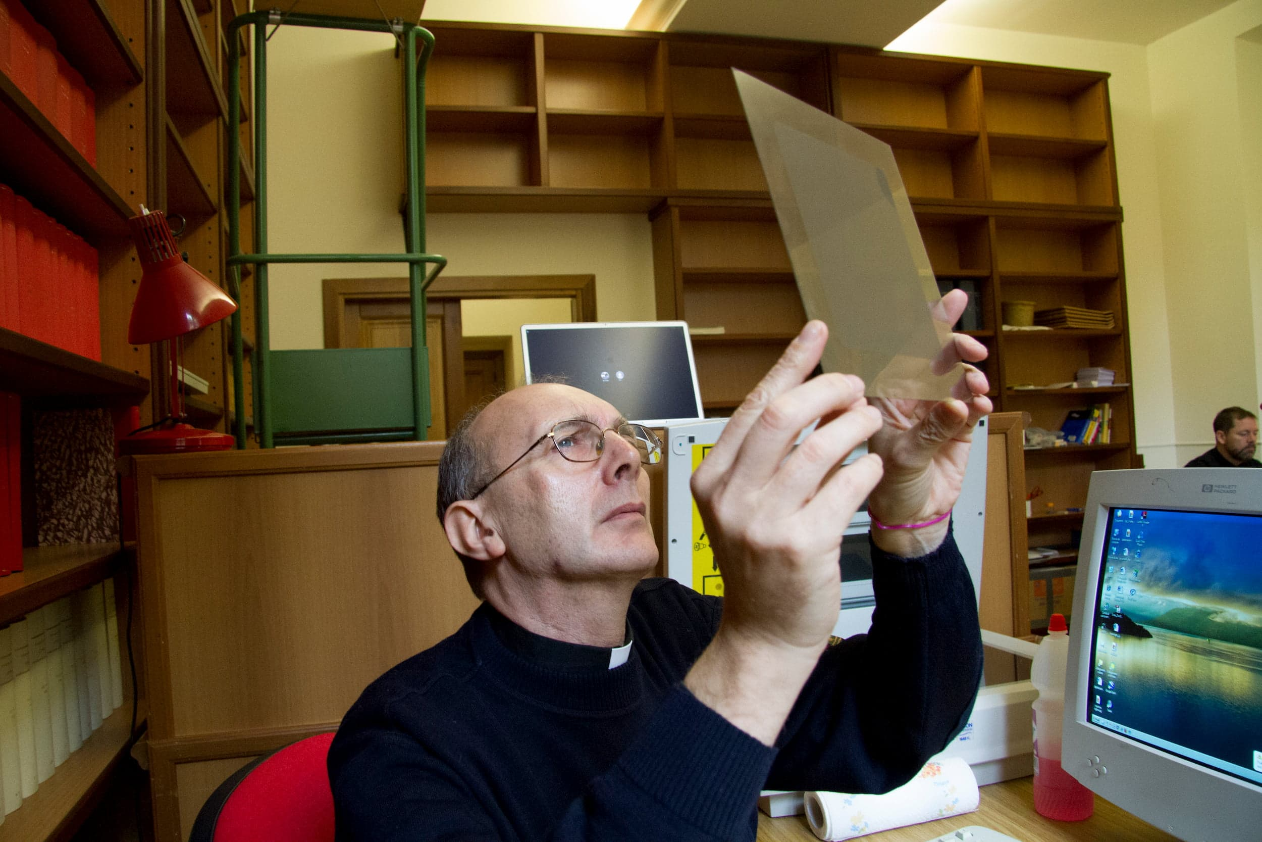 Fr. Alessandro Omizzolo inspecting a Carte du Ciel photographic plate
