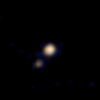 First Pluto-Charon Color Image from New Horizons, April 14, 2015. Credit: NASA/Johns Hopkins University Applied Physics Laboratory/Southwest Research Institute