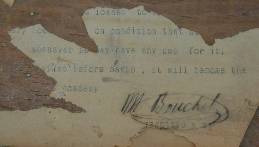 Bouchet's signature, on what appears to be the remnant of some instructions, affixed to the inside of the telescope's case, regarding what is to be done with the telescope.