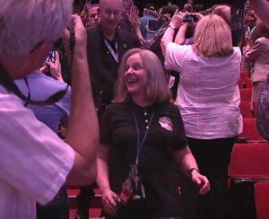 Bowman enters auditorium smiling post-contact
