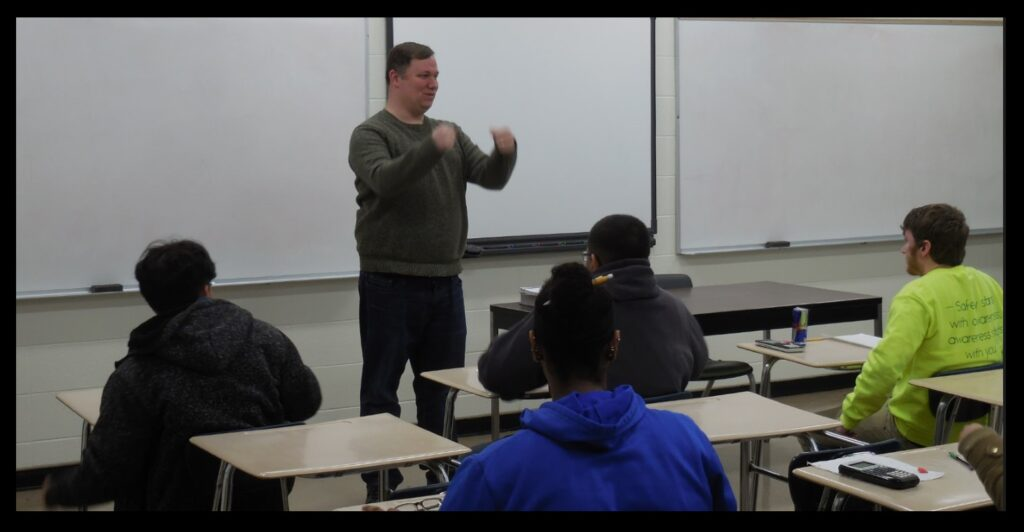 Chad in the classroom, getting a point across to his students.