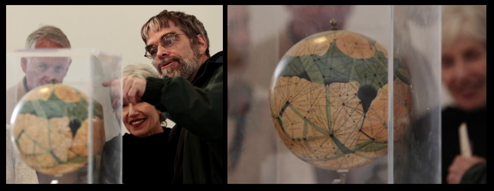 Left - Vatican Observatory Director Br. Guy Consolmagno, S. J., pointing out to visitors an old Mars globe in the V.O.'s collection.  Right - note the 'canals'.
