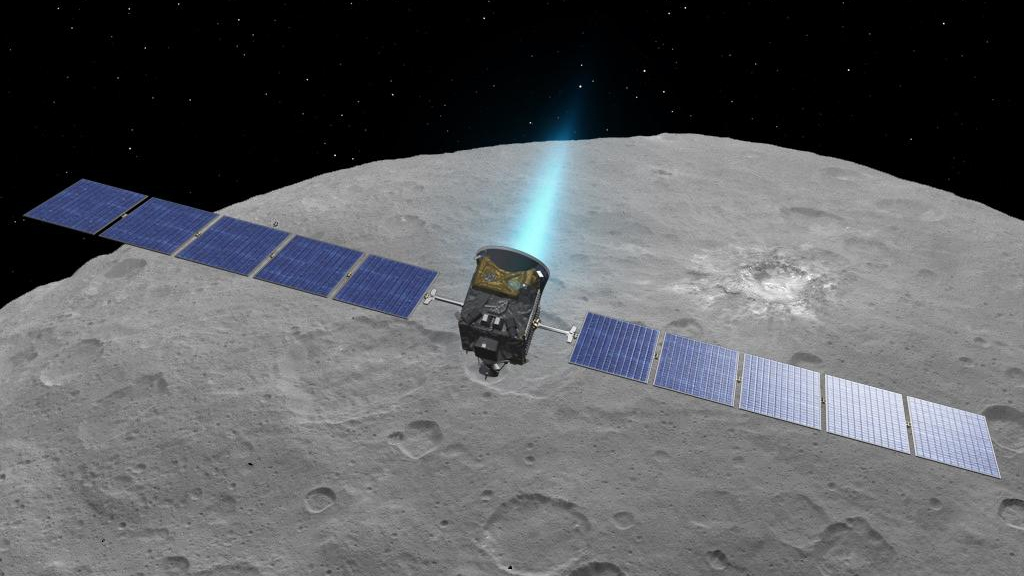 Artist concept of the Dawn spacecraft firing its ion engines above dwarf planet Ceres