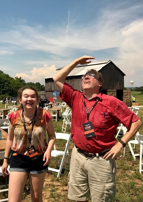 Seconds after totality ended, reporter Nicole Erwin of WKMS snapped this picture of the author watching Venus fade away, and daughter Nicole reacting to the corona.