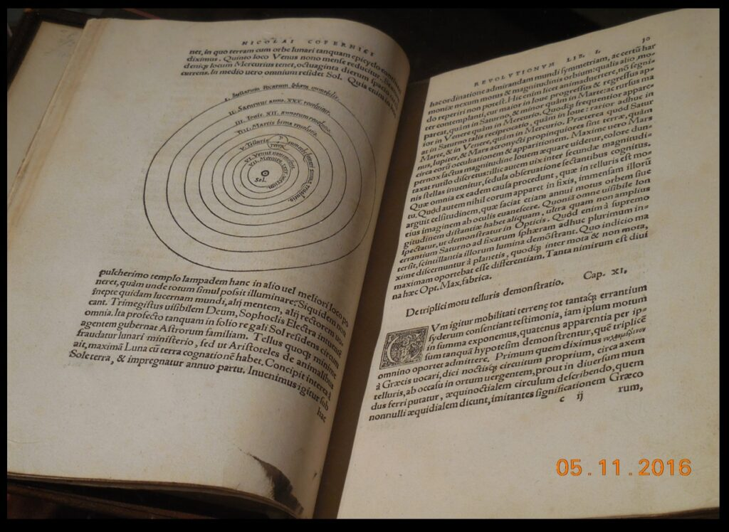 "A closer photo of the Bullitt Collection's copy of De Revolutionibus—open, of course, to the iconic diagram of the heliocentric system.  This book was printed in 1543, so it is nearly 500 years old, yet it looks ""like new.""  So, readers of The Catholic Astronomer, can you read the Latin?  Many of the books in the exhibit are written in Latin, which was the international language of science for a long time."