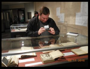 Prof. Chad Howard of Jefferson Community & Technical College, with some of the rare math and science books in the University of Louisville's Bullitt Collection.