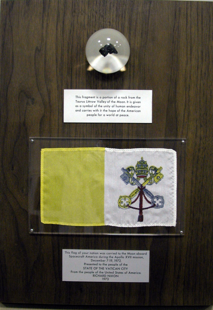 This plaque with a moon rock and a flag of the Vatican carried to the Moon by Apollo 17 resides today at the Observatory in Rome