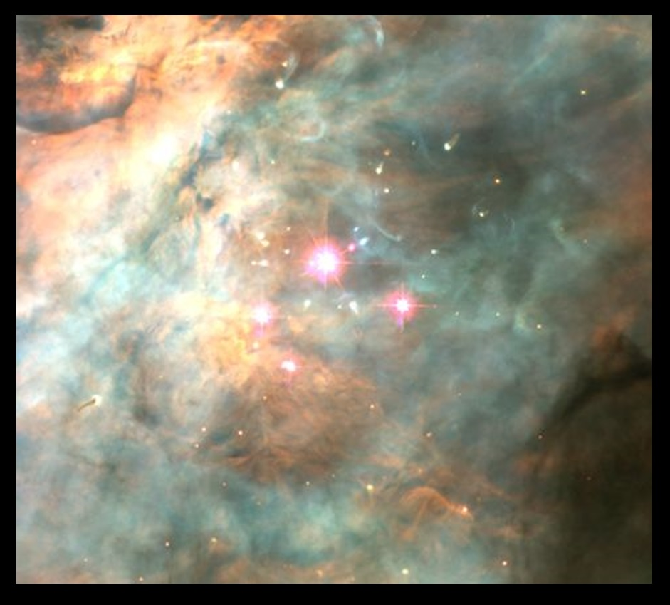 The bright stars forming the Trapezium asterism at the core of the Orion Nebula. The ultraviolet light of those stars keeps the gas of the nebula ionized and glowing. Credit: Hubble Space Telescope.