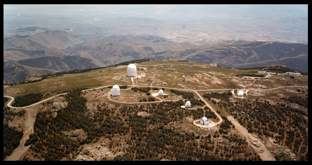 An aerial view of Calar Alto observatory, located at 2,100 meters altitude, in the province of Almería in Andalucía, Southern Spain. The biggest dome hosts a 3.5 meter telescope, the largest optical telescope in continental Western Europe. The 2.2 meter telescope with which we did the work described here is inside the leftmost dome.