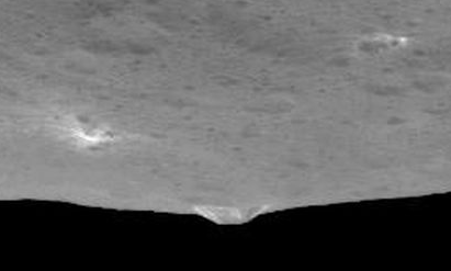 Dawn Survey Orbit Image 10 showing a side view of the mountain, and a light area. Image credit: NASA/JPL-Caltech/UCLA/MPS/DLR/IDA