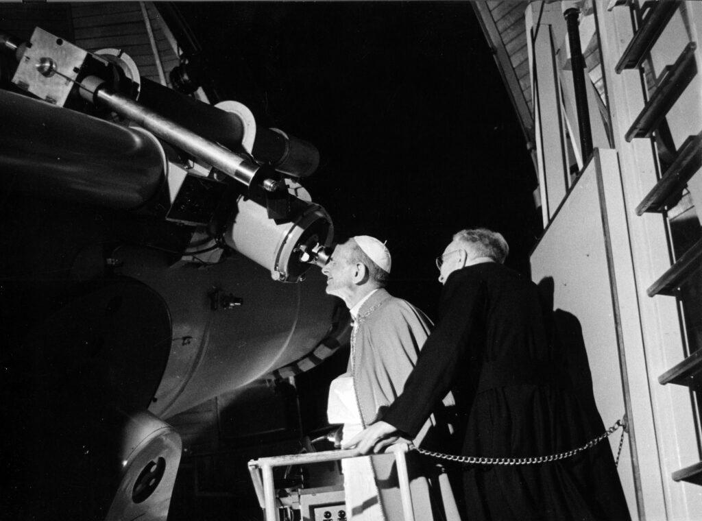 Pope Paul VI looking through a telescope