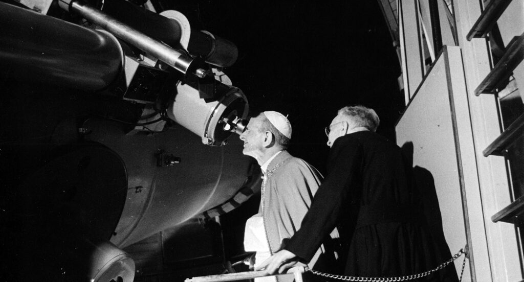 Pope St. Paul VI looking at the moon through the Vatican Observatory's Schmidt telescope, July 20, 1969.