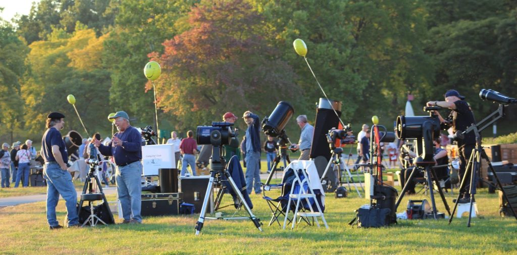 Solar telescopes everywhere at the Kensington Astronomy at the Beach event. Bob Trembley (left) is speaking with Mark Kedzior. Credit: Doug Bock.