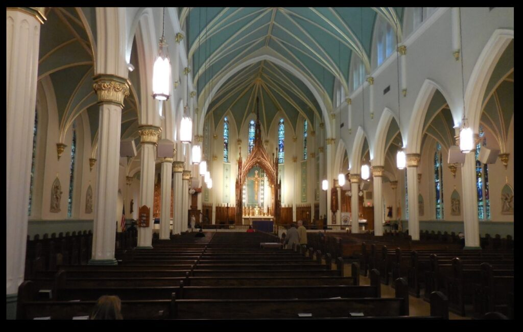 The interior of St. Louis Bertrand Church. Note the large baldacchino over the altar.