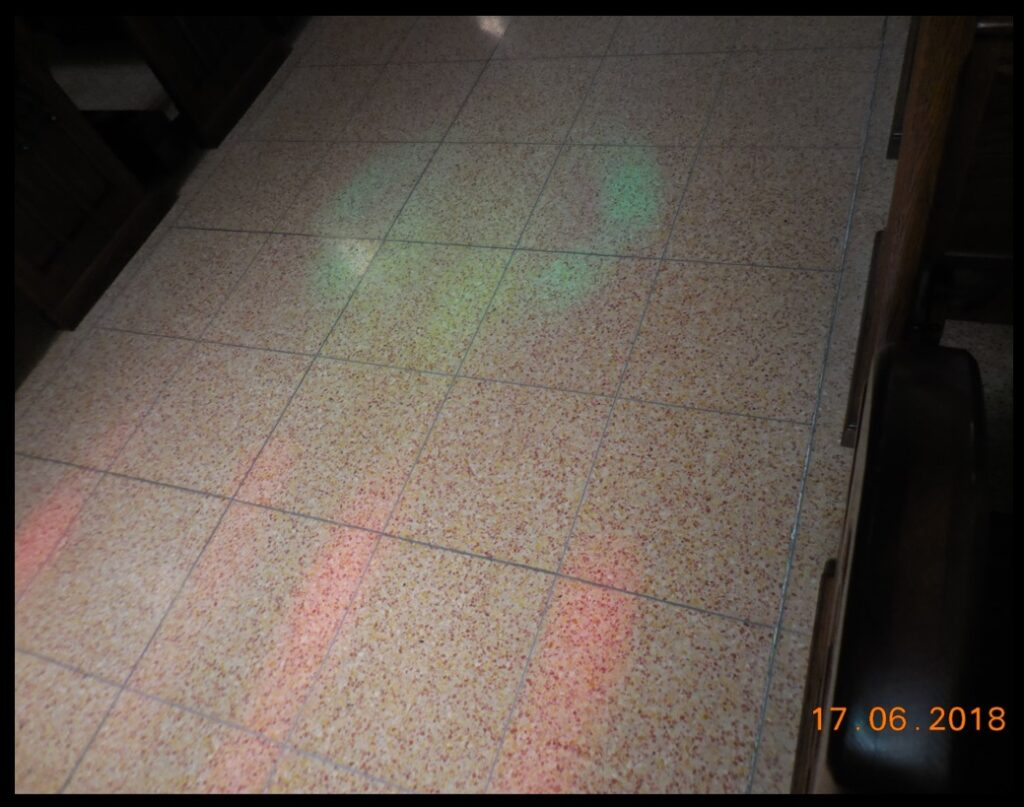 Light from the 'Veritas' window and other windows, at the 'Moment of Truth' on June 17. Note the red bands from other windows. Compare to the picture of the windows earlier in this post.
