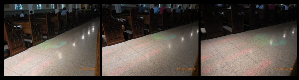 The 'Light of Truth' illuminating the aisle near the back of church, on June 17. This sequence of photos shows the blue-green circle moving across the aisle in the minutes prior to 10:30 AM. The light actually reached the center of the aisle for the 'Moment of Truth' at just about 10:30 AM.