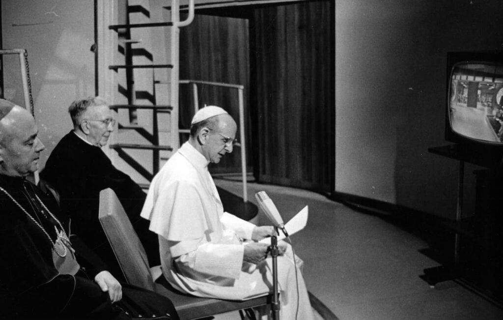 Pope St. Paul VI watching the Apollo 11 moon landing on TV and giving an address and blessing to the astronauts.