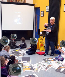 Deirdre telling the children that Buzz Aldrin and Michael Collins are still alive . This was news to them.