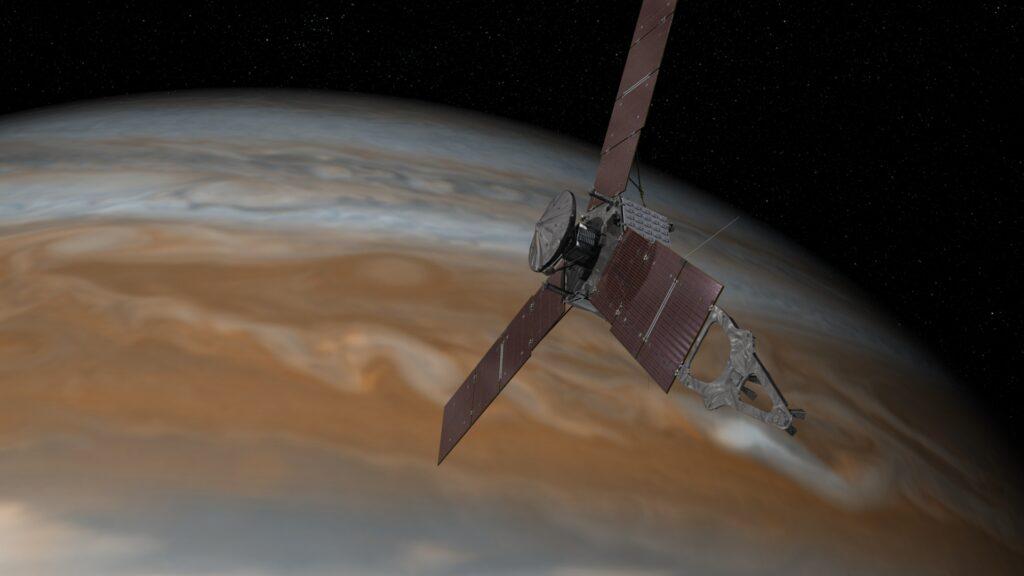 Artist's rendering showwin NASA's Juno spacecraft making one of its close passes over Jupiter. Credits: NASA/JPL-Caltech