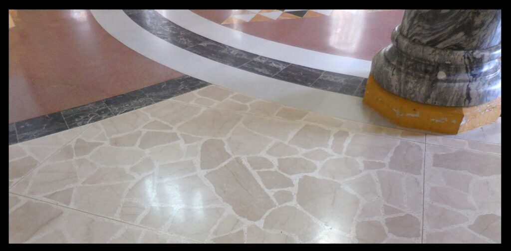 """The """"broken marble"""" of the side aisle."""